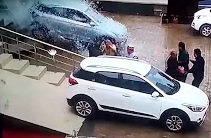 VIDEO: Disaster as customer smashes through dealership windows
