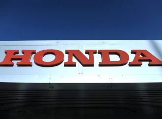 Honda cuts profit outlook as sales decline