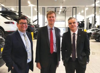 MP meets bosses and apprentices on visit to Porsche dealership