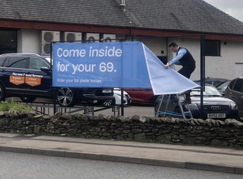 Cheeky 69 banner removed after complaint to dealership