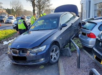 Driver crashes into dealership barriers after losing control of car